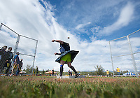 Robin Knebel competes in the stone throw during the 2015 Alaska Scottish Highland Games at the Palmer fairgrounds.