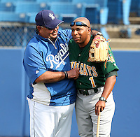 Lynchburg Hillcats hitting coach Bobby Moore #1 gets a hug from an unidentified Royals roving instructor before a game against the Wilmington Blue Rocks at Frawley Stadium on May 3, 2011 in Wilmington, Delaware.  Lynchburg defeated Wilmington by the score of 11-1.  Photo By Mike Janes/Four Seam Images