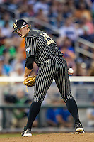Vanderbilt Commodores pitcher Carson Fulmer (15) looks towards the runner at first base during the NCAA College baseball World Series against the Cal State Fullerton Titans on June 14, 2015 at TD Ameritrade Park in Omaha, Nebraska. The Titans were leading 3-0 in the bottom of the sixth inning when the game was suspended by rain. (Andrew Woolley/Four Seam Images)
