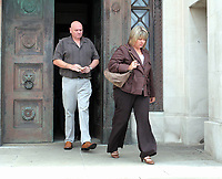 Pictured: The mother of Joshua Davies Hayley (R) and his father Steven (L) coming out of Swansea Crown court after their son's sentence. Friday 02 September 2011<br />