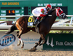 March 29, 2014: on Louisiana Derby Day at the Fairgrounds Race Course in New Orleans, LA. Mary M. Meek/ESW/CSM; Vicar's In Trouble, ridden by Rosie Napravnik, wins the Louisiana Derby.  Trainer Mike Maker, Owner Ken and Sarah Ramsey.