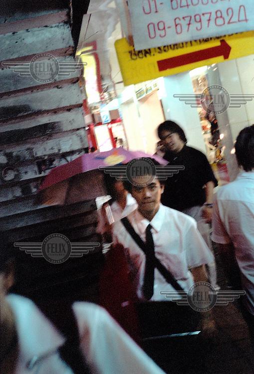 School children shopping in Bangkok's commercial centre, Siam Square.