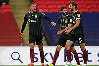 Harry Smith, Jordan Turnbull and Charlie Goode of Northampton Town celebrate their team's fourth goal during the Sky Bet League 2 PLAY-OFF Final match between Exeter City and Northampton Town at Wembley Stadium, London, England on 29 June 2020. Photo by Andy Rowland.