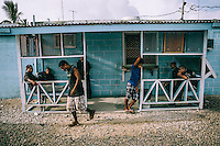 A group of men gather in a shelter to socialise. About 90 percent of the island's residents are unemployed. Hiding from the equatorial heat in their houses during the day, in the evening they go out to enjoy the evening freshness and get the latest news.