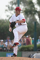 University of South Carolina Gamecocks pitcher Matt Price #22 on the mound during the 2nd and deciding game of the NCAA Super Regional vs. the University of Coastal Carolina Chanticleers on June 13, 2010 at BB&T Coastal Field in Myrtle Beach, SC.  The Gamecocks defeated Coastal Carolina 10-9 to advance to the 2010 NCAA College World Series in Omaha, Nebraska. Price pitched the 9th inning and earned the save. Photo By Robert Gurganus/Four Seam Images