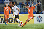 Andrija Kaluderovic of Brisbane Roar kicks a goal during the 2015 AFC Champions League match between the Brisbane Roar and the Urawa Red Diamonds on Tuesday, 5 May 2015 on the Gold Coast, Queensland, Australia. Photo by Matt Roberts / World Sport Group