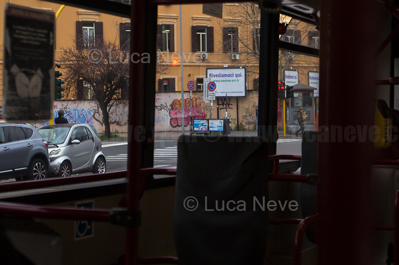San Giovanni district.<br /> <br /> Rome, Italy. 17th Mar, 2021. Documenting Rome from a Bus window (Number 81) and during a quick walk in the City center, while the new and tougher Covid-19 restrictions, imposed by Mario Draghi's Government, have been implemented since Monday morning in Rome, its surrounding Lazio Region, and other 9 Regions, including: Lombardia, Campania, Molise, Emilia Romagna, Friuli-Venezia Giulia, Marche, Piemonte, Puglia, Veneto and Autonomous Province of Trento. The local authorities tightened rules and restrictions due to a spike in the Covid-19 / Coronavirus cases. A new self-certification (autocertificazione, downloadable from here 1.) is needed to leave home which is allowed only for urgent reasons, mainly work and health. Italy will be placed under nationwide lockdown over the Easter weekend. <br /> <br /> Footnotes & Links:<br /> 1. http://www.regione.lazio.it/binary/rl_main/tbl_news/autocertificazione_1_.pdf