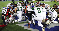 3 December 2009: Members of the New York Jets and the Buffalo Bills pray thanks after a game at the Rogers Centre in Toronto, Ontario, Canada. The Jets defeated the Bills 19-13. Mandatory Credit: Ed Wolfstein Photo
