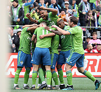 SEATTLE, WA - NOVEMBER 10: Kelvin Leerdam #18 of the Seattle Sounders FC is mobbed by teammates including Kim Kee-hee #20, Joevin Jones #33, Roman Torres #29, and Gustav Svensson #4 after scoring the game's first goal during a game between Toronto FC and Seattle Sounders FC at CenturyLink Field on November 10, 2019 in Seattle, Washington.