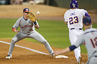 Auburn Tigers first baseman Garrett Cooper #28 makes a putout against the LSU Tigers in the NCAA baseball game on March 22nd, 2013 at Alex Box Stadium in Baton Rouge, Louisiana. LSU defeated Auburn 9-4. (Andrew Woolley/Four Seam Images).