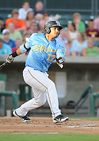 Catcher Tomas Telis (17) of the Myrtle Beach Pelicans in a game against the Frederick Keys on August 4, 2012, at TicketReturn.Com Field in Myrtle Beach, South Carolina. Myrtle Beach won, 4-3. (Tom Priddy/Four Seam Images).