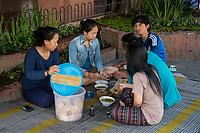 Yogyakarta, Java, Indonesia.  Eating Breakfast on the Sidewalk, early Morning, Malioboro Street.