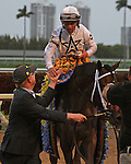 March 29, 2014:  #4 Constitution (KY) with jockey Javier Castellano on board duels with #1 Wildcat Red (KY) with jockey John Velazquez up to win the Florida Derby GI at Gulfstream Park in Hallandale Beach, FL.  Liz Lamont/ESW/CSM