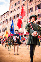 At the beginning of the parade of Il Palio di Siena, the standard-beareres carry the flags of the other towns