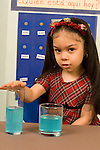 Piaget preoperational child girl age 4 conservation tests conservation of liquid vertical
