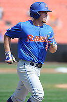 Florida Gators shortstop Nolan Fontana #4 runs to first during a game against the Tennessee Volunteers at Lindsey Nelson Stadium, Knoxville, Tennessee April 14, 2012. The Volunteers won the game 5-4  (Tony Farlow/Four Seam Images)..