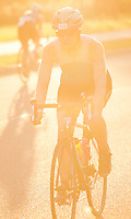 16 AUG 2014 - DARTFORD, GBR - Carol Summers from Dartford and White Oak Triathlon Club makes her way round the bike course during the 2014 Midnight Wo/Man triathlon in The Bridge area in Dartford, Great Britain (PHOTO COPYRIGHT © 2014 NIGEL FARROW, ALL RIGHTS RESERVED)