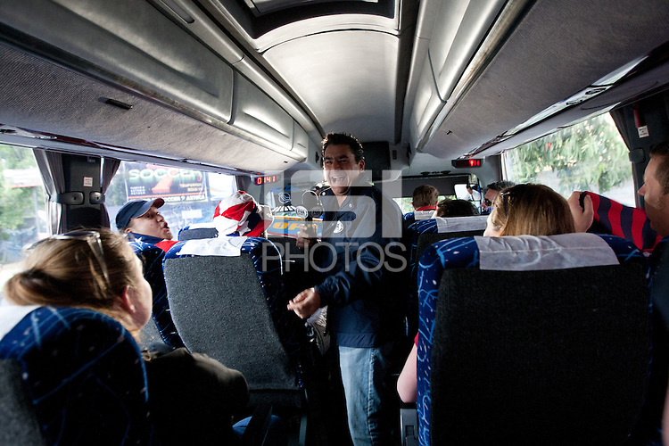 A reporter from Fox Sports boards a bus full of USA fans arriving for the USA vs. Mexico World Cup Qualifier at Azteca stadium in Mexico City, Mexico on March 26, 2013.