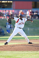 July 7, 2009: Salem-Keizer Volcanoes pitcher Mario Rodriguez pitches against the Tri-City Dust Devils during a Northwest League game at Volcanoes Stadium in Salem, Oregon