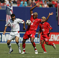 July 24, 2005: East Rutherford, NJ, USA: USMNT midfielder Landon Donovan (10) and Alberto Blanco (8) of Panama fight for the ball during the CONCACAF Gold Cup Finals at Giants Stadium.  The USMNT won 3-1 on penalty kicks.