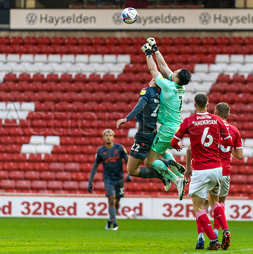 21st November 2020, Oakwell Stadium, Barnsley, Yorkshire, England; English Football League Championship Football, Barnsley FC versus Nottingham Forest; Jack Walton of Barnsley  punches the ball clear above Ryan Yates of Nottingham Forrest