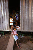 Belem, Brazil. Caboclo mother with four young children in their house; Cafezal, Para State, Amazon.