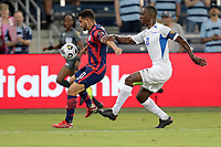 KANSAS CITY, KS - JULY 15: Cristian Roldan #10 of the United States moves with the ball during a game between Martinique and USMNT at Children's Mercy Park on July 15, 2021 in Kansas City, Kansas.
