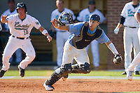 Catcher Mark Fleury #8 of the North Carolina Tar Heels rips off his mask as he chases down a throw at Boshamer Stadium May 30, 2010, in Chapel Hill, North Carolina.  Photo by Brian Westerholt / Four Seam Images