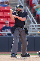 Home plate umpire Blake Selter makes a strike call during a South Atlantic League game between the Greensboro Grasshoppers and the Hickory Crawdads at  L.P. Frans Stadium July 10, 2010, in Hickory, North Carolina.  Photo by Brian Westerholt / Four Seam Images