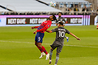 ST PAUL, MN - SEPTEMBER 9: Thiago Santos #5 of FC Dallas and Emanuel Reynoso #10 of Minnesota United FC battle for the ball during a game between FC Dallas and Minnesota United FC at Allianz Field on September 9, 2020 in St Paul, Minnesota.