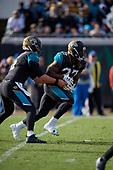 Jacksonville Jaguars running back Leonard Fournette (27) takes the handoff from quarterback Blake Bortles (5) during an NFL Wild-Card football game against the Buffalo Bills, Sunday, January 7, 2018, in Jacksonville, Fla.  (Mike Janes Photography)