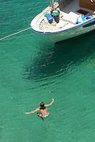 - Lampedusa island, the more southern part of the Italian territory, in front of the Tunisinian African coasts, tourist boats in the Calandra bay<br /> <br /> - isola di Lampedusa, la parte del territorio italiano più meridionale, di fronte alle coste africane tunisine, barche turistiche nella Cala Calandra