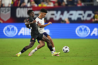 NASHVILLE, TN - SEPTEMBER 5: Antonee Robinson #5 of USA races past Richie Laryea #22 of Canada during a game between Canada and USMNT at Nissan Stadium on September 5, 2021 in Nashville, Tennessee.
