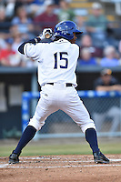 Asheville Tourists designated hitter Raimel Tapia #15 awaits a pitch during a game against the Savannah Sand Gnats at McCormick Field July 16, 2014 in Asheville, North Carolina. The Tourists defeated the Sand Gnats 6-3. (Tony Farlow/Four Seam Images)