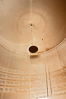 Inside a stainless steel fermentation vat, the stick is the temperature measuring device (thermometer) and on the walls you can see the cooling coils, looking up you can see the filling hole  Chateau Thieuley La Sauve Majeure  Entre-deux-Mers  Bordeaux Gironde Aquitaine France