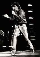 Montreal (Qc) CANADA - File Photo - circa 1983 - Robert Charlebois in concert.<br /> <br /> Photo by Denis Alix, File Photo - -Robert Charlebois in concert, circa 1983 <br /> <br /> Photo by Denis Alix - Agence Quebec Presse