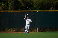 South Dakota State Jackrabbits center fielder Landon Badger (11) catches a fly ball during a game against the Northeastern Huskies on February 23, 2019 at North Charlotte Regional Park in Port Charlotte, Florida.  Northeastern defeated South Dakota State 12-9.  (Mike Janes/Four Seam Images)