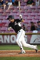 Dylan Manwaring (9) of the Salem-Keizer Volcanoes bats against the Eugene Emeralds at Volcanoes Stadium on July 24, 2017 in Keizer, Oregon. Eugene defeated Salem-Keizer, 7-6. (Larry Goren/Four Seam Images)