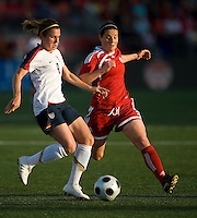 Heather O'Reilly, Rhian Wilkinson. The US Women's National Team defeated the Canadian Women's National Team, 4-0, at BMO Field in Toronto during an international friendly soccer match on May 25, 2009.