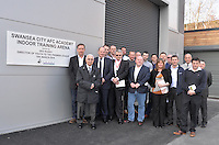 Friday 18th March 2016<br /> Club employees by the unveiled plaque<br /> Official opening of the Swansea City Landore Academy which includes a 3rd floor classroom, an extension and an indoor training barn