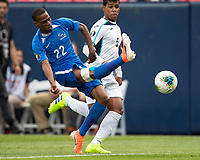 DENVER, CO - JUNE 19: Romario Barthelery #22 kicks the ball while Daniel Morejon #5 looks on during a game between Martinique and Cuba at Broncos Stadium on June 19, 2019 in Denver, Colorado.