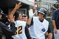 Trenton Thunder  infielder Greg Bird (37) is greeted by team mates after hitting his second home run of the game against the Altoona Curve at ARM & HAMMER Park on August 6, 2014 in Trenton, NJ.  Trenton defeated Altoona 7-3.  (Tomasso DeRosa/Four Seam Images)