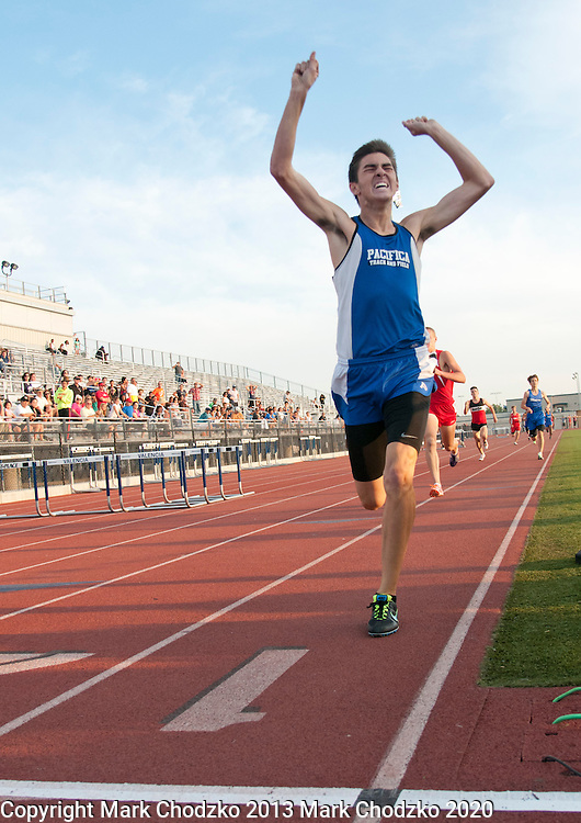 Pacifica's Ernesto Leyva raise his arms in victory while winning the 800 Meter Run in Friday's Empire League track and Field finals at Valencia.<br /> ///ADDITIONAL INFORMATION:<br /> 5/3/13, MARK CHODZKO, FOR THE REGISTER<br /> Empire League Track and Field Finals at Valencia High School