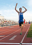 Pacifica's Ernesto Leyva raise his arms in victory while winning the 800 Meter Run in Friday's Empire League track and Field finals at Valencia.<br />