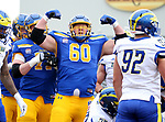 BROOKINGS, SD - MAY 8: Offensive lineman Mason McCormick #60 of the South Dakota State Jackrabbits flexes his muscles showing their strength against the Delaware Fightin Blue Hens on May 8, 2021 in Brookings, South Dakota. (Photo by Dave Eggen/Inertia)
