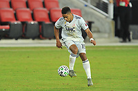 WASHINGTON, DC - SEPTEMBER 27: Brandon Bye #15 of New England Revolution plays the ball during a game between New England Revolution and D.C. United at Audi Field on September 27, 2020 in Washington, DC.