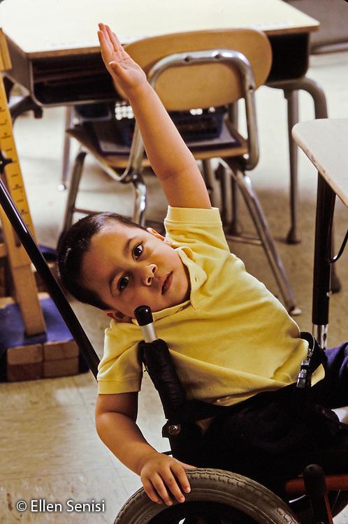 MR / Schenectady, NY.Zoller Public School-Inclusion Class-Grade 1.Boy (7, Bangledeshi and Puerto-Rican-American, spina bifida, sacral agenesis) raises hand in class..MR: Rah1.PN#: 28591                     FC#: 21675-00113.scan from slide.© Ellen B. Senisi