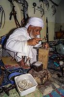 Rustaq, Oman.  Rashid al-Obeidani, Silversmith, in his Workshop, Making a Silver Ring.