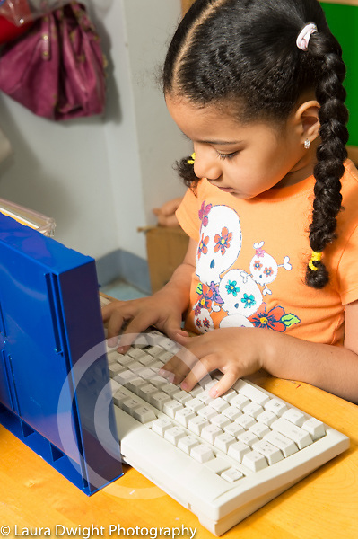 Education preschool 4 year olds pretend play girl using pretend computer