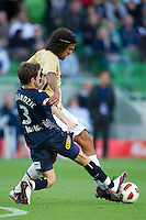 MELBOURNE, AUSTRALIA - DECEMBER 27: Mate Dugandzic of the Victory and Nikolai Topor-Stanley of the Jets contest the ball during the round 20 A-League match between the Melbourne Victory and the Newcastle Jets at AAMI Park on December 27, 2010 in Melbourne, Australia. (Photo by Sydney Low / Asterisk Images)